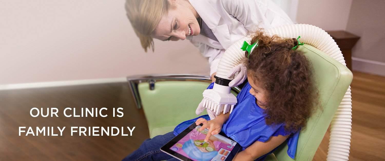 technician letting little girl feel head from device on head