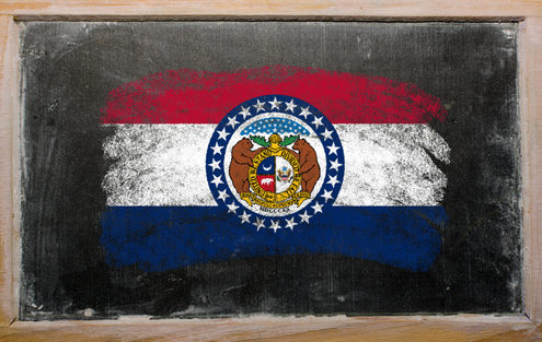 Missouri State Flag on classroom blackboard. State policy about lice in schools.